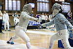 12 February 2017: UNC's Meredith Bozentka (left) and Duke's Jennifer Ling (right) during Saber. The Duke University Blue Devils hosted the University of North Carolina Tar Heels at Card Gym in Durham, North Carolina in a 2017 College Women's Fencing match. Duke won the dual match 14-13 overall and 7-2 in Epee. UNC won Foil 6-3 and Saber 5-4.