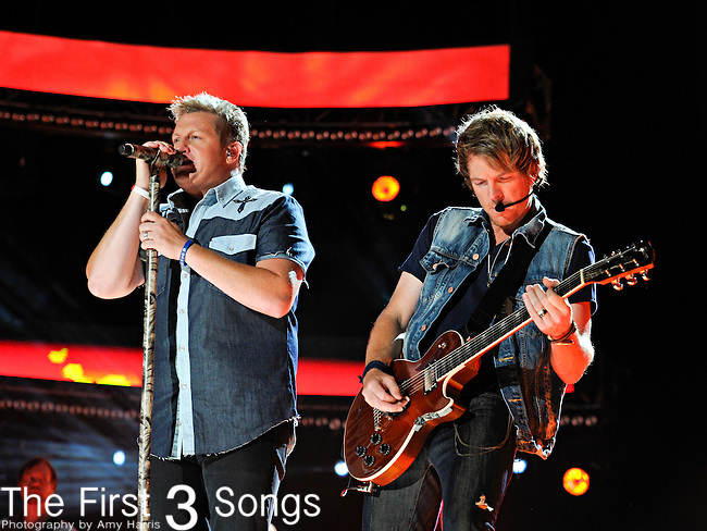 Gary LeVox and Joe Don Rooney of Racal Flatts perform at LP Field during the 2012 CMA Music Festival on June 10, 2011 in Nashville, Tennessee.