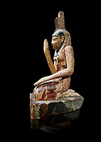 Ancient Egyptian wooden statue of osiris weeping, Late Period (664-332 BC). Egyptian Museum, Turin. Drovetti Cat 203.  Grey background.