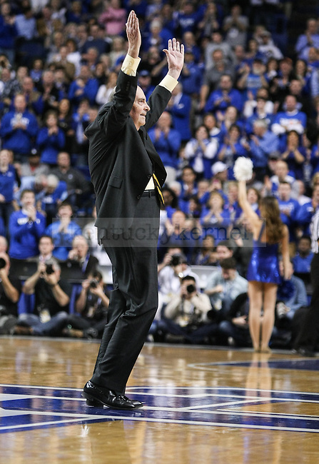 Herky Rupp, son of former Kentucky basketball coach Adolf Rupp, waves to the crowd during the second half of the Kentucky vs. Florida game at Rupp Arena in Lexington, Ky.,on Saturday, March 7, 2015. UK defeated Florida 67-50, completing a perfect regular season. Photo by Adam Pennavaria | Staff
