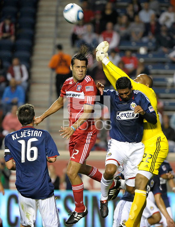 Chivas goalkeeper Zach Thorton (22) punches the ball away from Chicago defender Wilman Conde (22).  The Chicago Fire tied Chivas USA 1-1 at Toyota Park in Bridgeview, IL on May 1, 2010.