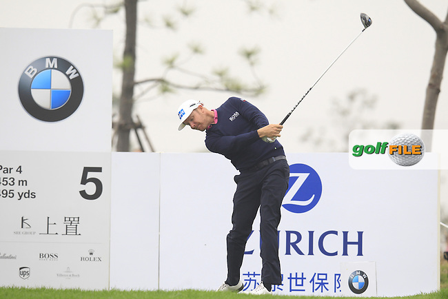 Mikko Ilonen (FIN) tees off the 5th tee during Saturay's Round 3 of the 2014 BMW Masters held at Lake Malaren, Shanghai, China. 1st November 2014.<br /> Picture: Eoin Clarke www.golffile.ie