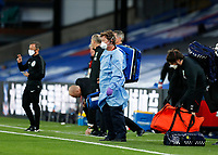 29th June 2020; Selhurst Park, London, England; English Premier League Football, Crystal Palace versus Burnley Football Club; A staff member from the Medical Team in full PPE outfit prepares to come onto the pitch during the 2nd half