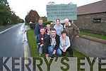 Residents in Barraduff Headford are so frustrated that they have erected a sign hitting out at Kerry County Council's inaction on the main Killarney Mallow road. <br /> Front L-R Donie McSweeney, Jerry O'Leary and Cait Looney. <br /> Back L-R Tim Looney, David Lawlor and Orla Murphy.