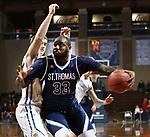 SIOUX FALLS, SD - MARCH 9:  Raheem Bowman #33 of St. Thomas drives past Austin Roetman #33 of Briar Cliff at the 2018 NAIA DII Men's Basketball Championship at the Sanford Pentagon in Sioux Falls. (Photo by Dick Carlson/Inertia)