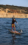 LA JOLLA, CA - FEBRUARY 28:  Waterman Roch Frey paddles on his stand-up paddleboard (SUP) in front of Torrey Pines State Reserve on February 28, 2012 in La Jolla, California. (Photo by Donald Miralle)