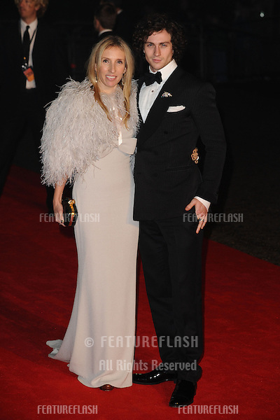 "Sam and Aaron Taylor-Johnson arriving for the ""Skyfall"" world premiere after party at the Tate Modern, London. 23/10/2012 Picture by: Steve Vas / Featureflash"