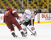 Dan Ford (Harvard - 5), Mike McLaughlin (Northeastern - 18) - The Harvard University Crimson defeated the Northeastern University Huskies 3-2 in the 2012 Beanpot consolation game on Monday, February 13, 2012, at TD Garden in Boston, Massachusetts.