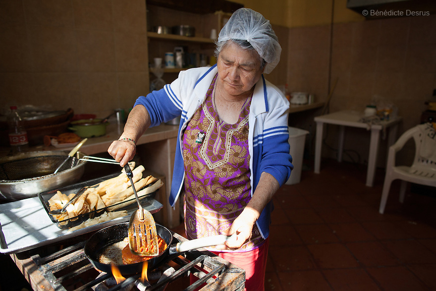 Carmelita, resident of Casa Xochiquetzal, prepares lunch at the shelter in Mexico City, Mexico on September 14, 2012. Casa Xochiquetzal is a shelter for elderly sex workers in Mexico City. It gives the women refuge, food, health services, a space to learn about their human rights and courses to help them rediscover their self-confidence and deal with traumatic aspects of their lives. Casa Xochiquetzal provides a space to age with dignity for a group of vulnerable women who are often invisible to society at large. It is the only such shelter existing in Latin America. Photo by Bénédicte Desrus