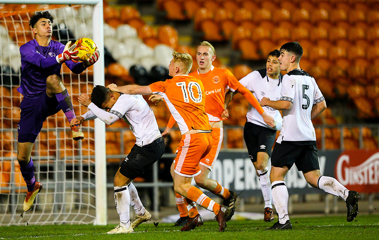 Derby County's Bradley Foster-Theniger makes a save under pressure from Blackpool's Owen Watkinson<br /> <br /> Photographer Alex Dodd/CameraSport<br /> <br /> The FA Youth Cup Third Round - Blackpool U18 v Derby County U18 - Tuesday 4th December 2018 - Bloomfield Road - Blackpool<br />  <br /> World Copyright &copy; 2018 CameraSport. All rights reserved. 43 Linden Ave. Countesthorpe. Leicester. England. LE8 5PG - Tel: +44 (0) 116 277 4147 - admin@camerasport.com - www.camerasport.com