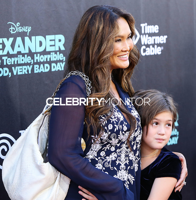HOLLYWOOD, LOS ANGELES, CA, USA - OCTOBER 06: Tia Carrere, Audrey Duhinio Janairo arrive at the World Premiere Of Disney's 'Alexander And The Terrible, Horrible, No Good, Very Bad Day' held at the El Capitan Theatre on October 6, 2014 in Hollywood, Los Angeles, California, United States. (Photo by Xavier Collin/Celebrity Monitor)