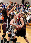 Waterbury, CT- 30, December 2010-123010CM11 Holy Cross' Brianna Ferraro looks for an open shot as Torrington's Mariah Cerruto (left) and Brittany Kackowski (right) defend Thursday night in Waterbury. Holy Cross defeated Torrington, 50-44 to remain undefeated on the season. Christopher Massa Republican-American