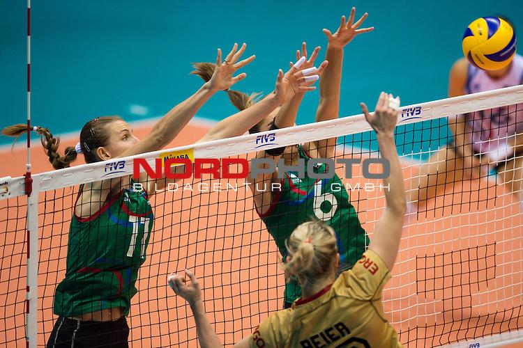 05.10.2014, Pala Trieste, Triest<br /> Volleyball, FIVB Volleyball Women`s World Championship 2014, 2. Runde, Deutschland (GER) vs. Aserbaidschan (AZE)<br /> <br /> Block / Doppelblock Katerina Zhidkova (#11 AZE), Ayshan Abdulazimova (#6 AZE) - Angriff Heike Beier (#12 GER)<br /> <br />   Foto &copy; nordphoto / Kurth