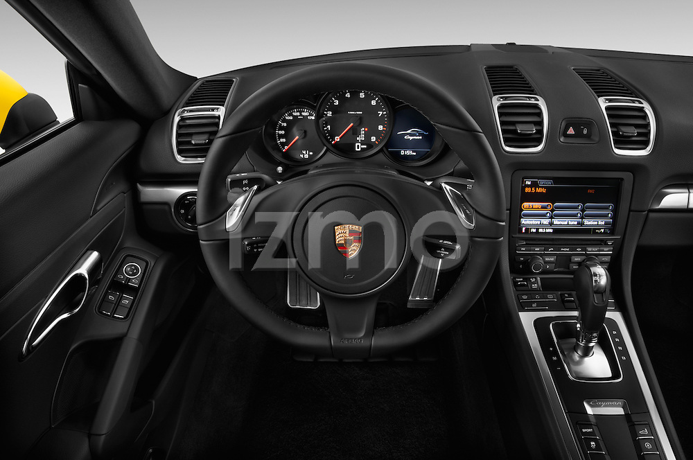 Steering wheel view of a 2014 Porsche Caymen Coupe