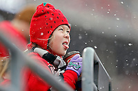 Kaitlyn Grill, 8, of Cleveland drinks her hot chocolate while watching Ohio State Buckeyes warm up in the snow before their game against Indiana Hoosiers at Ohio Stadium in Columbus, Ohio on November  Center on November 23, 2013.  (Dispatch photo by Kyle Robertson)