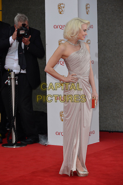 Kimberly Wyatt.Arqiva British Academy Television Awards in 2013 at the Royal Festival Hall, London, England..12th May 2013.BAFTA BAFTAS full length grey gray one shoulder dress hand on hip profile silver .CAP/PL.©Phil Loftus/Capital Pictures