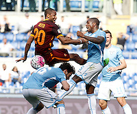 Calcio, Serie A: Lazio vs Roma. Roma, stadio Olimpico, 3 aprile 2016.<br /> Roma's Seydou Keita, top left, fights for the ball against Lazio's Marco Parolo, bottom, and Edson Braafheid, during the Italian Serie A football match between Lazio and Roma at Rome's Olympic stadium, 3 April 2016.<br /> UPDATE IMAGES PRESS/Isabella Bonotto