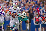 14 September 2014: Buffalo Bills quarterback EJ Manuel scrambles to pass during play against the Miami Dolphins at Ralph Wilson Stadium in Orchard Park, NY. The Bills defeated the Dolphins 29-10 to win their home opener and start the season with a 2-0 record. Mandatory Credit: Ed Wolfstein Photo *** RAW (NEF) Image File Available ***