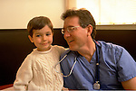 doctor laughing with young boy patient
