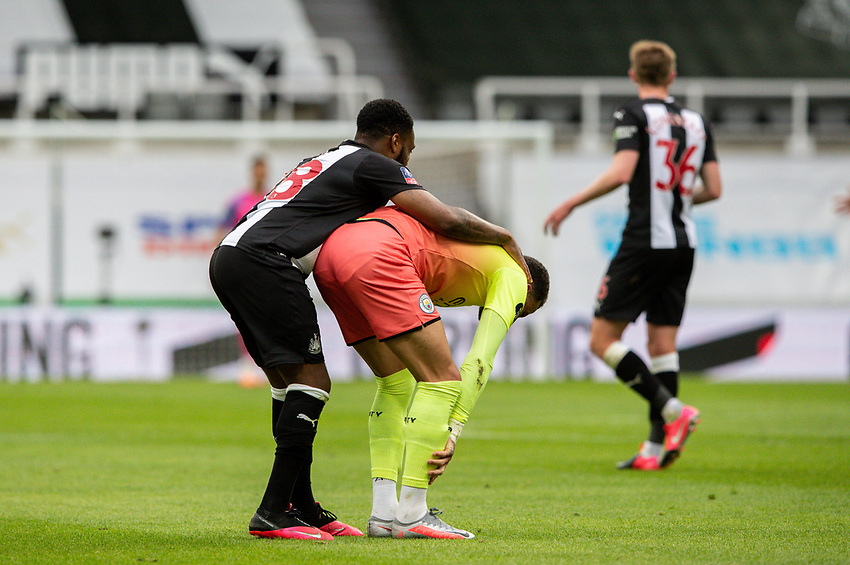 Newcastle United's Danny Rose tries to help Manchester City's Kyle Walker to his feet<br /> <br /> Photographer Alex Dodd/CameraSport<br /> <br /> FA Cup Quarter-Final - Newcastle United v Manchester City - Sunday 28th June 2020 - St James' Park - Newcastle<br />  <br /> World Copyright © 2020 CameraSport. All rights reserved. 43 Linden Ave. Countesthorpe. Leicester. England. LE8 5PG - Tel: +44 (0) 116 277 4147 - admin@camerasport.com - www.camerasport.com
