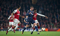 Joe Willock of Arsenal  battles Nenad Krsticic of Crvena Zvezda (Red Star Belgrade) during the UEFA Europa League group stage match between Arsenal and FC Red Star Belgrade at the Emirates Stadium, London, England on 2 November 2017. Photo by PRiME Media Images.