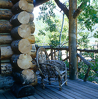 This lodge in Aspen, Colorado is made of massive chinked logs which can be seen here from the decked porch