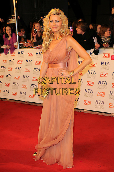 TESS DALY.The National Television Awards at O2 Arena, London, England..January 26th, 2011.NTA NTAs full length beige pink dress gold clutch bag maxi sheer grecian cuff bracelet .CAP/CAS.©Bob Cass/Capital Pictures.