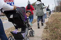 NWA Democrat-Gazette/CHARLIE KAIJO Noemi Castro, 4, of Rogers looks back at marchers chanting on Friday, November 10, 2017 during a rally and three mile march that started at Rogers High School in Rogers. Marchers met to express support for the Dream Act and TPS (Temporary Protective Status). The march in Rogers is the third of a four-city tour for supporters of Dreamers. The final march will be in Bentonville in December, mostly likely before Congress goes into recess, said Andrea Garcia, a spokesman for the group.