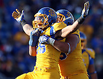 BROOKINGS, SD - OCTOBER 26:  Charles Elmore #29 and Bryan Burke #55 from South Dakota State University celebrate a sack against Northern Iowa in the fourth quarter of their game Saturday afternoon at Coughlin Alumni Stadium in Brookings. (Photo by Dave Eggen/Inertia)