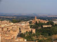 Basilica di San Maria de Servi and Tuscan fields surrounding Siena, Ital