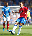 Lee McCulloch clears from midfield