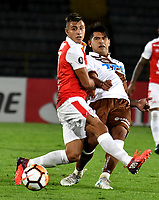BOGOTA - COLOMBIA - 20 - 02 - 2018: Juan Roa (Izq.) jugador de Independiente Santa Fe disputa el balón con Adrian Cuadra (Der.) jugador de Santiago Wanderers, durante partido de vuelta entre Independiente Santa Fe (COL) y Santiago Wanderers (CHL), de la fase 3 llave 1, por la Copa Conmebol Libertadores 2018, jugado en el estadio Nemesio Camcho El Campin de la ciudad de Bogota. / Juan Roa (L) player of Independiente Santa Fe vies for the ball with Adrian Cuadra (R) player of Santiago Wanderers, during a match for the second leg between Independiente Santa Fe (COL) and Santiago Wanderers (CHL), of the 3rd phase key 1, for the Copa Conmebol Libertadores 2018 at the Nemesio Camacho El Campin Stadium in Bogota city. Photo: VizzorImage  / Luis Ramirez / Staff.
