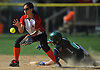 Jessica Hom #3, Syosset shortstop, left, fields a throw as Ashley Casazza #1 of Seaford slides safely into second base in the top of the first inning of a non-league varsity softball game at Syosset High School on Wednesday, Apr. 27, 2016. Syosset won by a score of 4-3.
