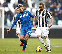 Calcio, Serie A: Juventus - Sassuolo, Torino, Allianz Stadium, 4 Febbraio 2018. <br /> Juventus' Gonzalo Higuain (r) in action with Sassuolo's Domenico Berardi (l) during the Italian Serie A football match between Juventus and Sassuolo at Torino's Allianz stadium, February 4, 2018.<br /> UPDATE IMAGES PRESS/Isabella Bonotto