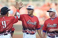 Bernardo Flores (32) of the Winston-Salem Dash high fives Anderson Tejeda (9) of the Down East Wood Ducks during player introductions prior to the start of the 2018 Carolina League All-Star Classic at Five County Stadium on June 19, 2018 in Zebulon, North Carolina. The South All-Stars defeated the North All-Stars 7-6.  (Brian Westerholt/Four Seam Images)
