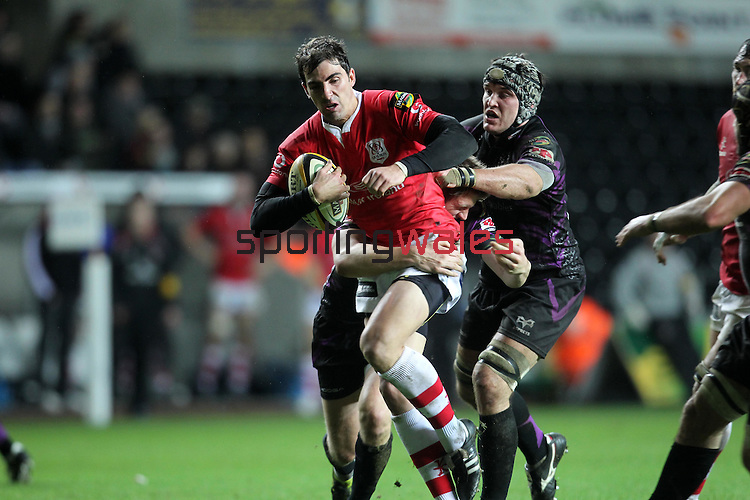 Ruan Pienaar tries to break through the Ospreys defence..Magners League.Ospreys v Ulster.13.02.11.©Steve Pope