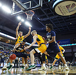 SIOUX FALLS, SD - MARCH 8: Emmanuel Nzekwesi #23 of the Oral Roberts Golden Eagles tries to control the ball in the lane against the North Dakota State Bison at the 2020 Summit League Basketball Championship in Sioux Falls, SD. (Photo by Richard Carlson/Inertia)