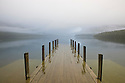 Wooden pier at Lake Rotoiti in rain; dawn; New Zealand, South Island