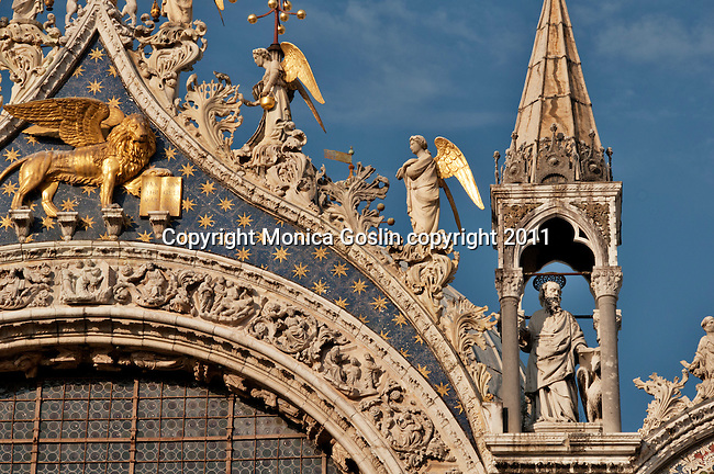 Detail of the sculptures and the gold lion on the facade of Saint Mark's Basilica in Venice, Italy