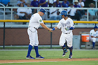Cristhian Vasquez (44) of the Burlington Royals shakes hands with third base coach Scott Thorman (16) after hitting a home run against the Princeton Rays at Burlington Athletic Stadium on August 12, 2016 in Burlington, North Carolina.  The Royals defeated the Rays 9-5.  (Brian Westerholt/Four Seam Images)