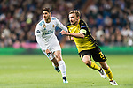 Borussia Dortmund Defender Marcel Schmelzer (R) in action against Marco Asensio of Real Madrid (L) during the Europe Champions League 2017-18 match between Real Madrid and Borussia Dortmund at Santiago Bernabeu Stadium on 06 December 2017 in Madrid Spain. Photo by Diego Gonzalez / Power Sport Images