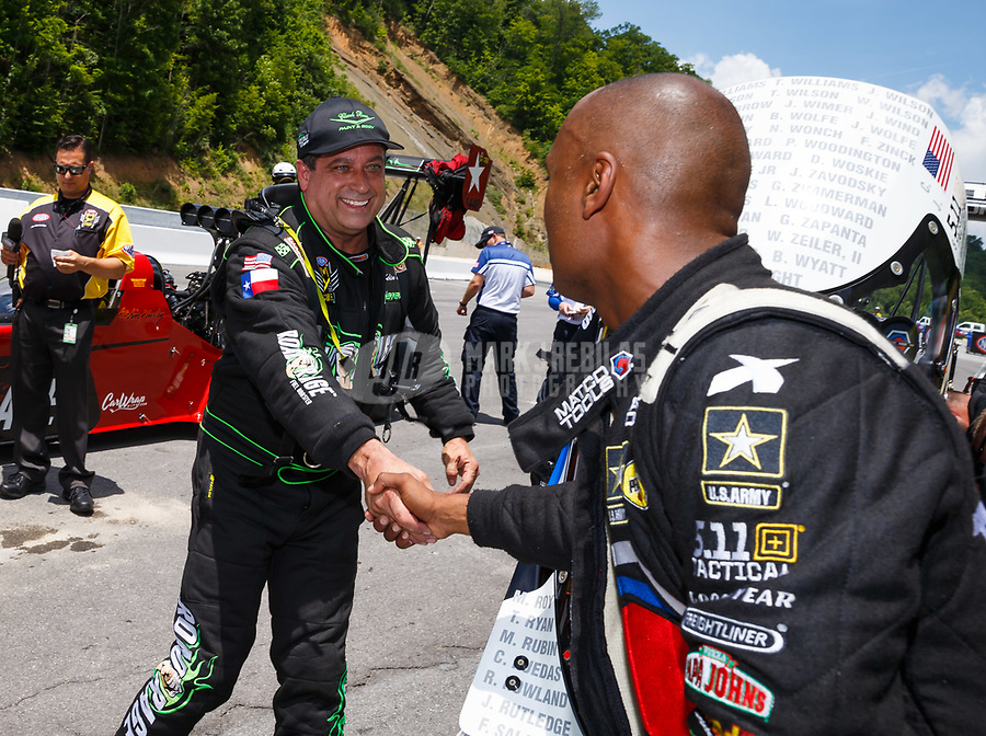 Jun 17, 2017; Bristol, TN, USA; NHRA top fuel driver Kebin Kinsley (left) greets Antron Brown during qualifying for the Thunder Valley Nationals at Bristol Dragway. Mandatory Credit: Mark J. Rebilas-USA TODAY Sports