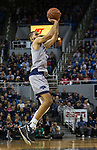 Nevada forward Caleb Martin (10) takes a jump shot against South Dakota State in the first half of an NCAA college basketball game in Reno, Nev., Saturday, Dec. 15, 2018. (AP Photo/Tom R. Smedes)