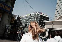 ROMANIA / Bucharest / 19 August 2009 / A woman in piata Victoriei, the new financial area of the city. © Davin Ellicson / Anzenberger