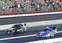 Feb. 17, 2013; Pomona, CA, USA; NHRA funny car driver Robert Hight (right) races alongside Cruz Pedregon during first round of eliminations at the Winternationals at Auto Club Raceway at Pomona. Mandatory Credit: Mark J. Rebilas-