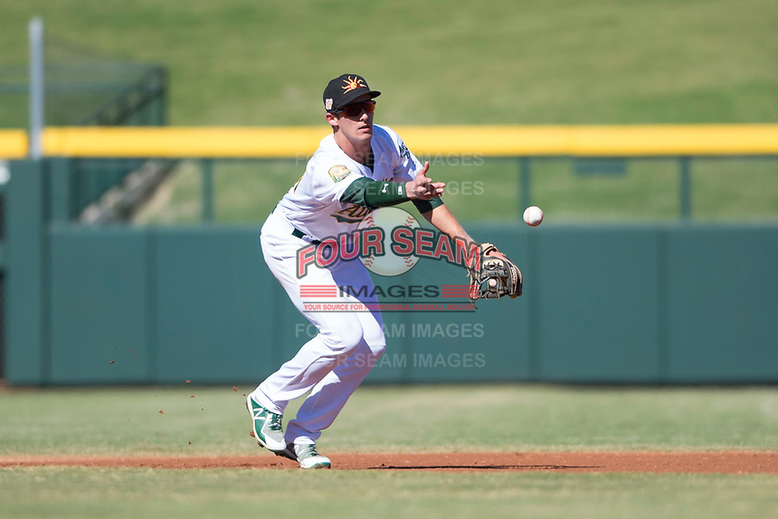 Mesa Solar Sox shortstop Eli White (21), of the Oakland Athletics organization, flips a ball to second base during an Arizona Fall League game against the Surprise Saguaros at Sloan Park on November 1, 2018 in Mesa, Arizona. Surprise defeated Mesa 5-4 . (Zachary Lucy/Four Seam Images)