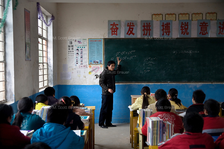 A teacher leads class in Xiaoliji Middle School in Lianshui County, Jiangsu Province, China.  The Pfrang Association, a German charity based in Nanjing, China, sponsors a number of children in the school, providing money for boarding, food, clothing, school supplies, and other necessities to continue schooling.  The majority of children at this school come from poor farming families in rural Jiangsu Province, China.