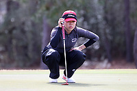 WALLACE, NC - MARCH 09: Kristen Min Ju Kim of Boston University lines up a putt on the 14th green of the River Course at River Landing Country Club on March 09, 2020 in Wallace, North Carolina.
