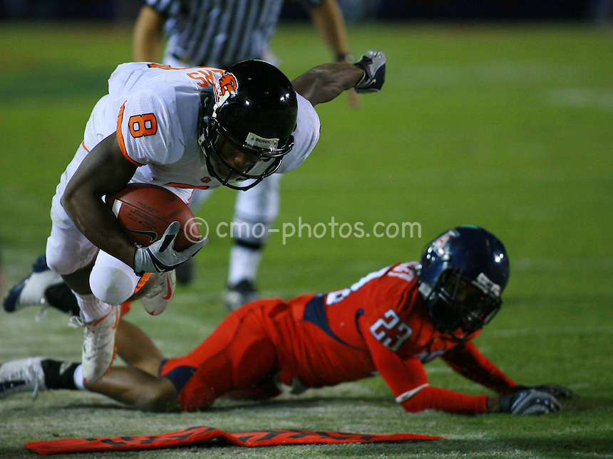 Nov 22, 2008; Tucson, AZ, USA; Oregon State wide receiver James Rodgers (8) dives for the first down marker after being pushed out of bounds by Arizona Wildcats cornerback Marquis Hundley (23) in the second quarter of a game at Arizona Stadium.