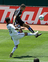 20 June 2009: Ryan Johnson of the Earthquakes fights for a loose ball against A.J. DeLaGarza of the Galaxy during the game at Oakland-Alameda County Coliseum in Oakland, California.   Earthquakes defeated Galaxy at 2-1.
